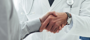 Suncoast Cancer Institute Doctor and Patient Shaking Hands